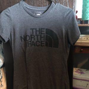 Gray north face shirt.